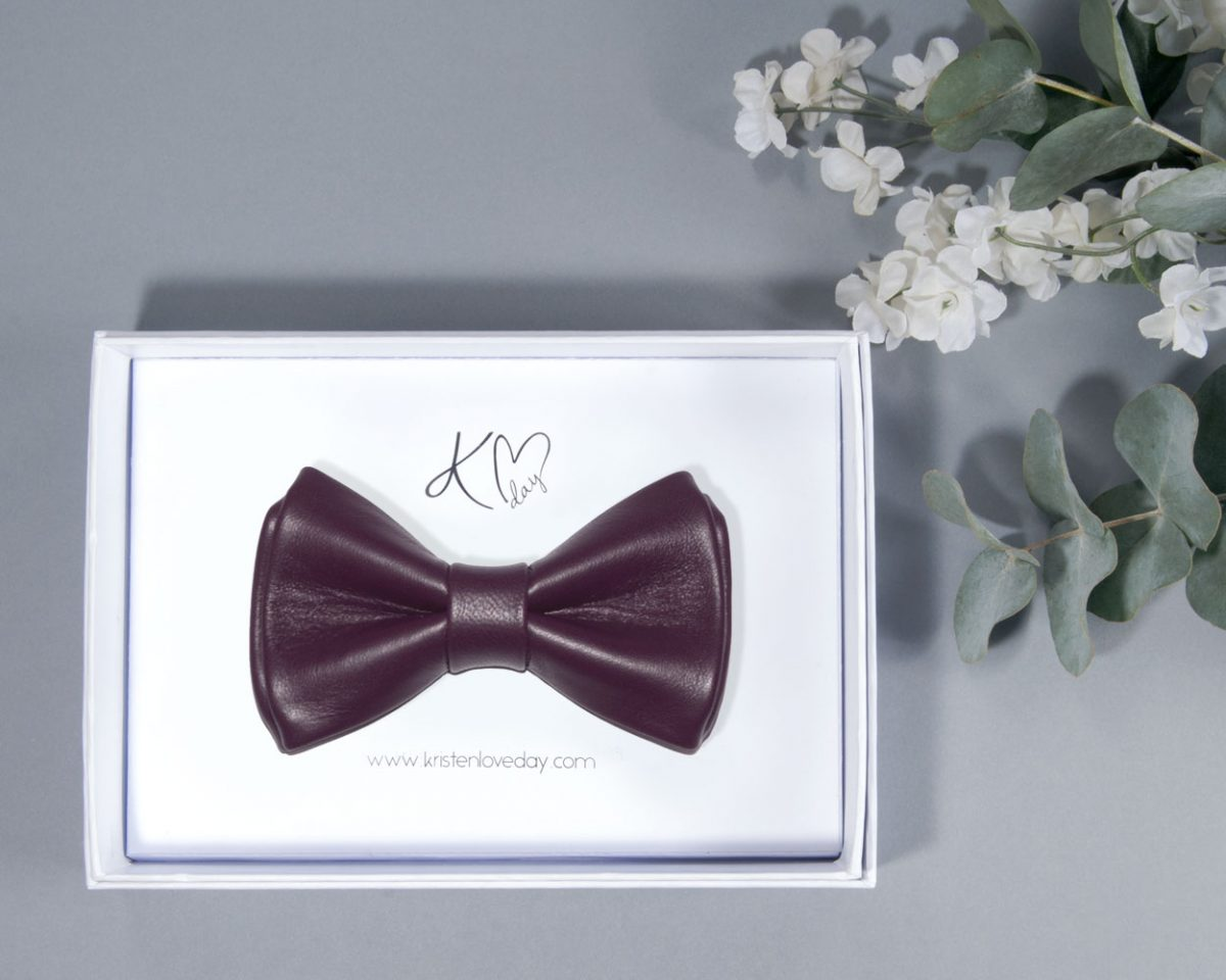 Plum Valencia Nappa Leather Bow Tie inside it's box
