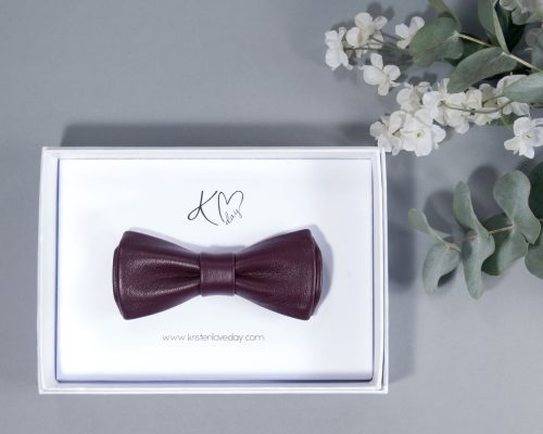 Plum Valencia Narrow Nappa Leather Bow Tie inside it's box