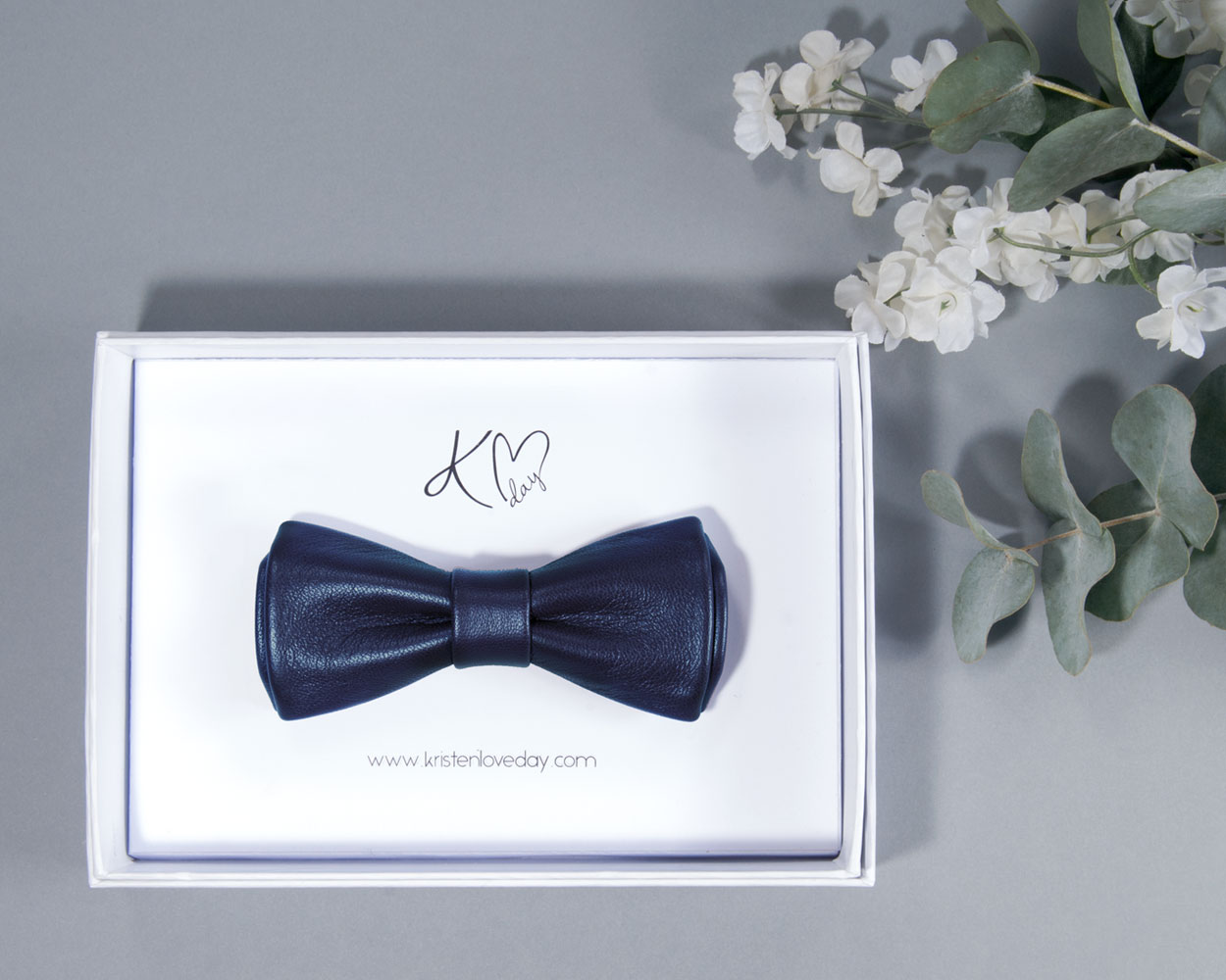 Petrol Narrow Metallic Leather Bow Tie inside it's box